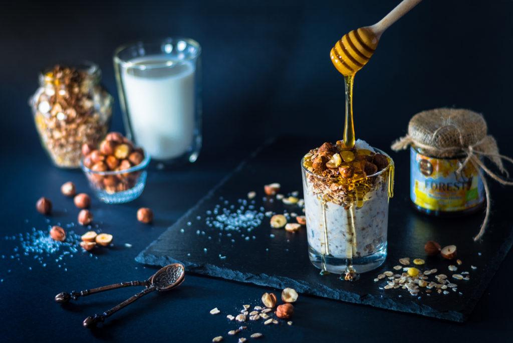 Honey jar and healthy breakfast